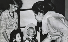 American children present gifts to Queen Homeira at the 1968 Jeshyn Fair.  