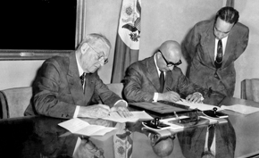 Prime Minister Mohammed Daoud and Secretary of State John Foster Dulles sign a cultural exchange agreement. 