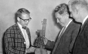 Louis Dupree receives Afghan musical instruments from A.R. Benawa (center), Director of Radio Kabul.