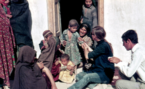 Peace Corps Volunteer Margery Bickler vaccinates Afghan villagers.