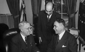 President Harry S. Truman confers with Prime Minister Shah Mahmood (right) and Afghan Chargé d'affaires Abdul Hamid Aziz (center).