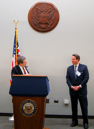 Senator Kirk and Ambassador Holliday interact during remarks