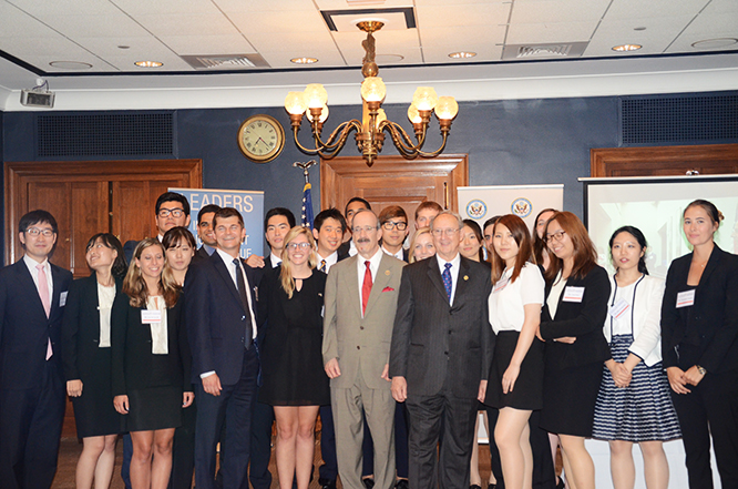 Scott Thompson, Director and Senior Counsel, Government Relations, Samsung Electronics America, Representative Eliot Engel, and Maryland Secretary of State John Wobensmith with 2015 Exchange Participants and Alumni.