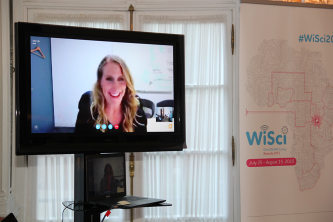 "Sara Link, President of the AOL Charitable Foundation, exemplifies ""Women in Science and Technology,"" addressing the audience remotely."