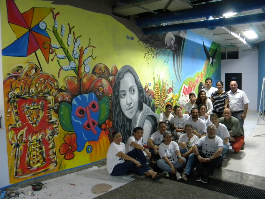 The group of artists with the completed mural at the end of the day