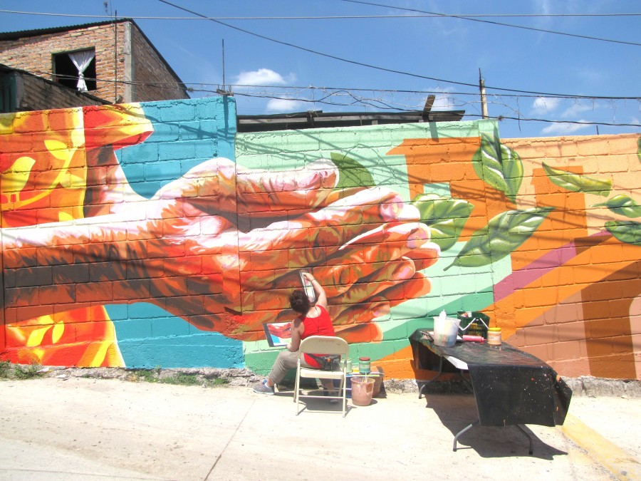 Artist Michelle Ortiz working on some of the mural details