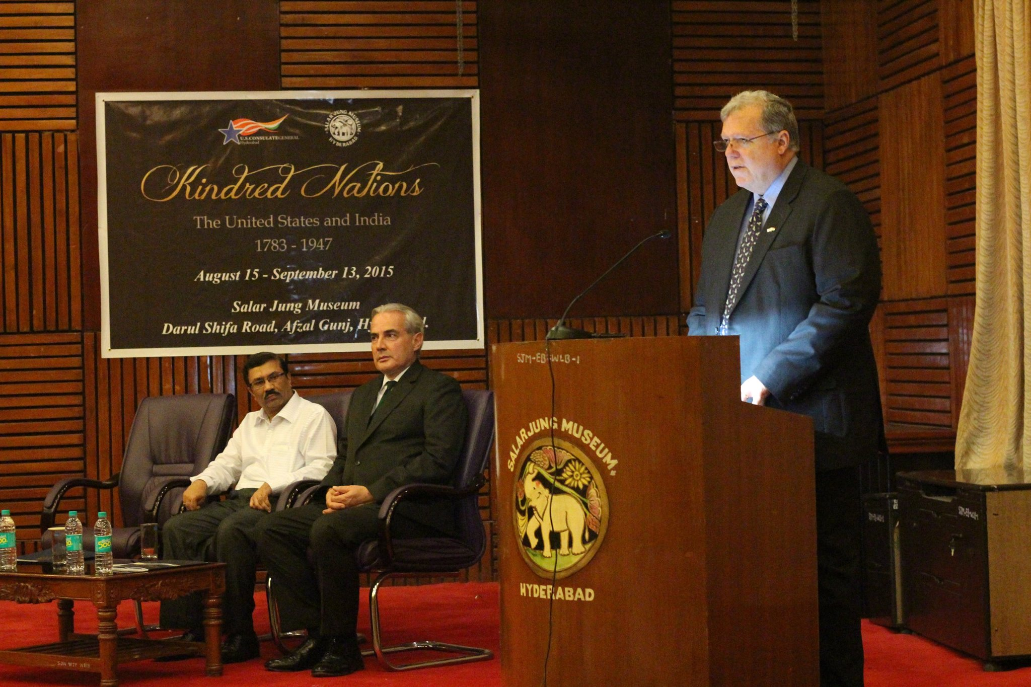 Acting Consul General B. Jamison Fouss speaks at the opening of Kindred Nations in Hyderabad at the Salar Jung Museum & Library, while museum director A. Nagender Reddy and Public Affairs Officer Gabriel Hons-Olivier listen.
