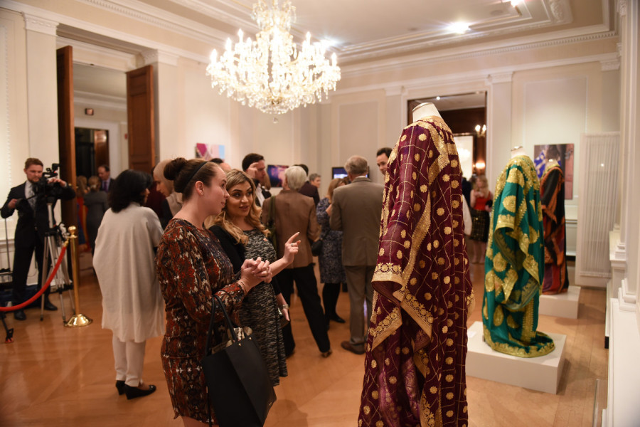 Guests view some of the traditional Bahraini thobs on display.