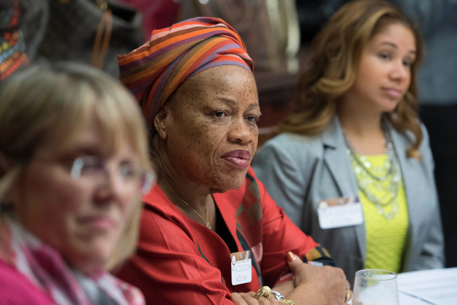Julia Duncan-Cassell, Liberia's Minister of Gender and Development, listens to remarks.