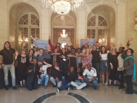 IVLP participants and leaders from DC's Art Community pose for a group photo in Meridian House after a successful speed convening session