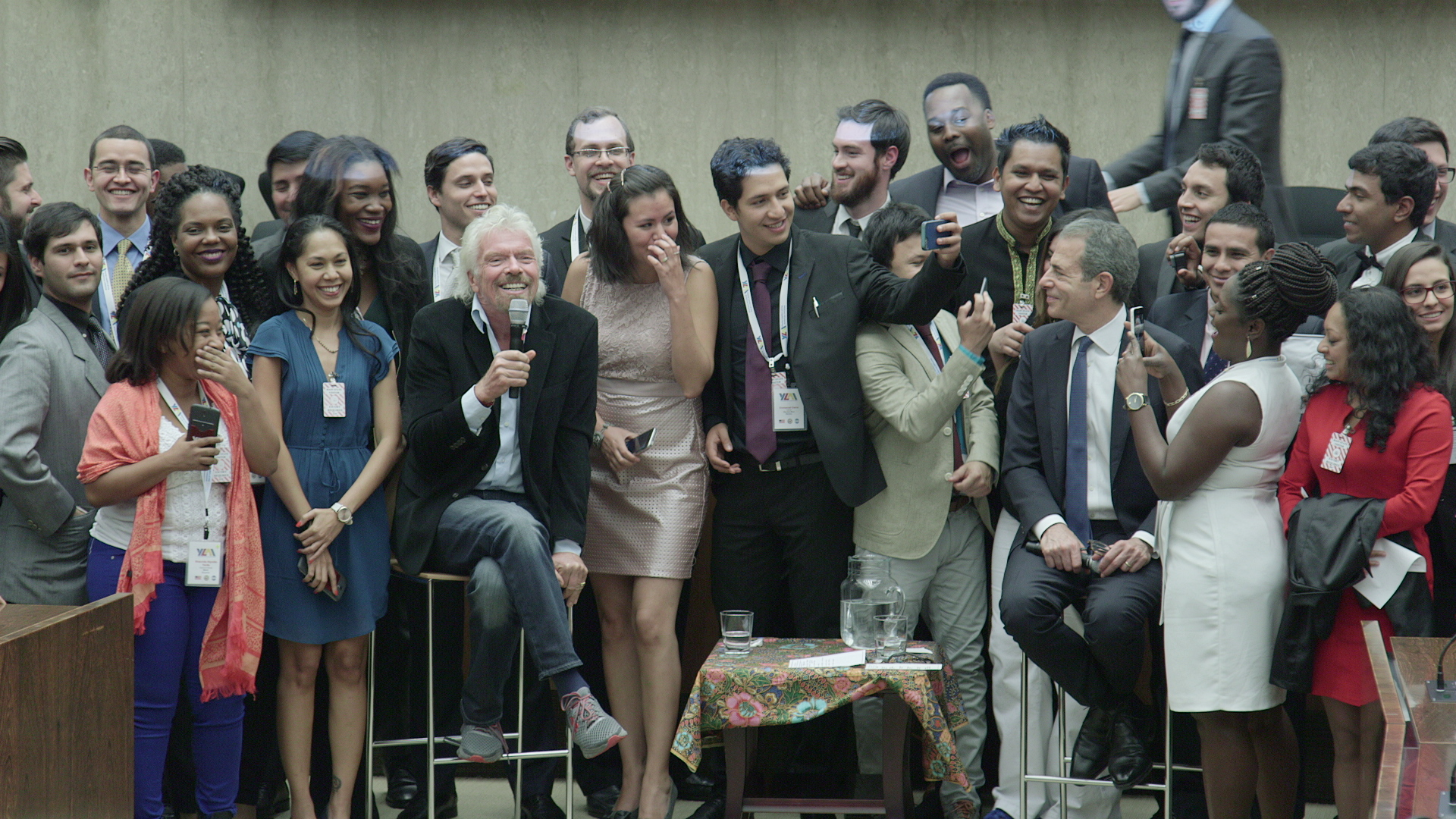 Sir Richard Branson and Rick Stengel meeting with Fellows of the Young Leaders of the Americas Initiative (YLAI)