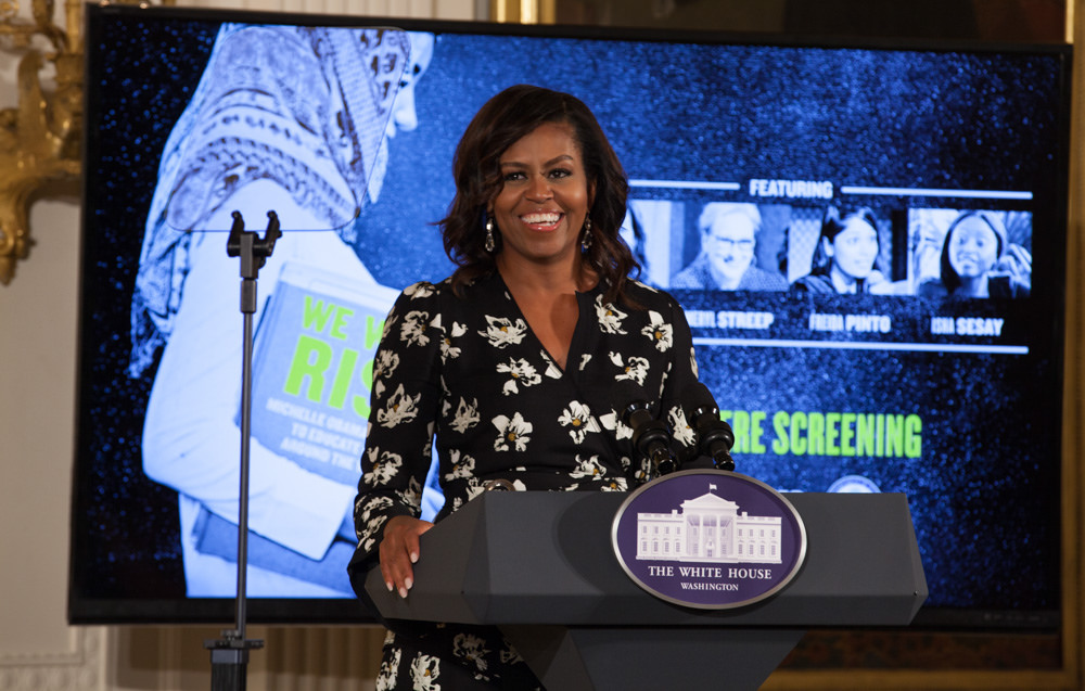 First Lady Michelle Obama addresses the Let Girls Learn participants at the We Will Rise film screening.