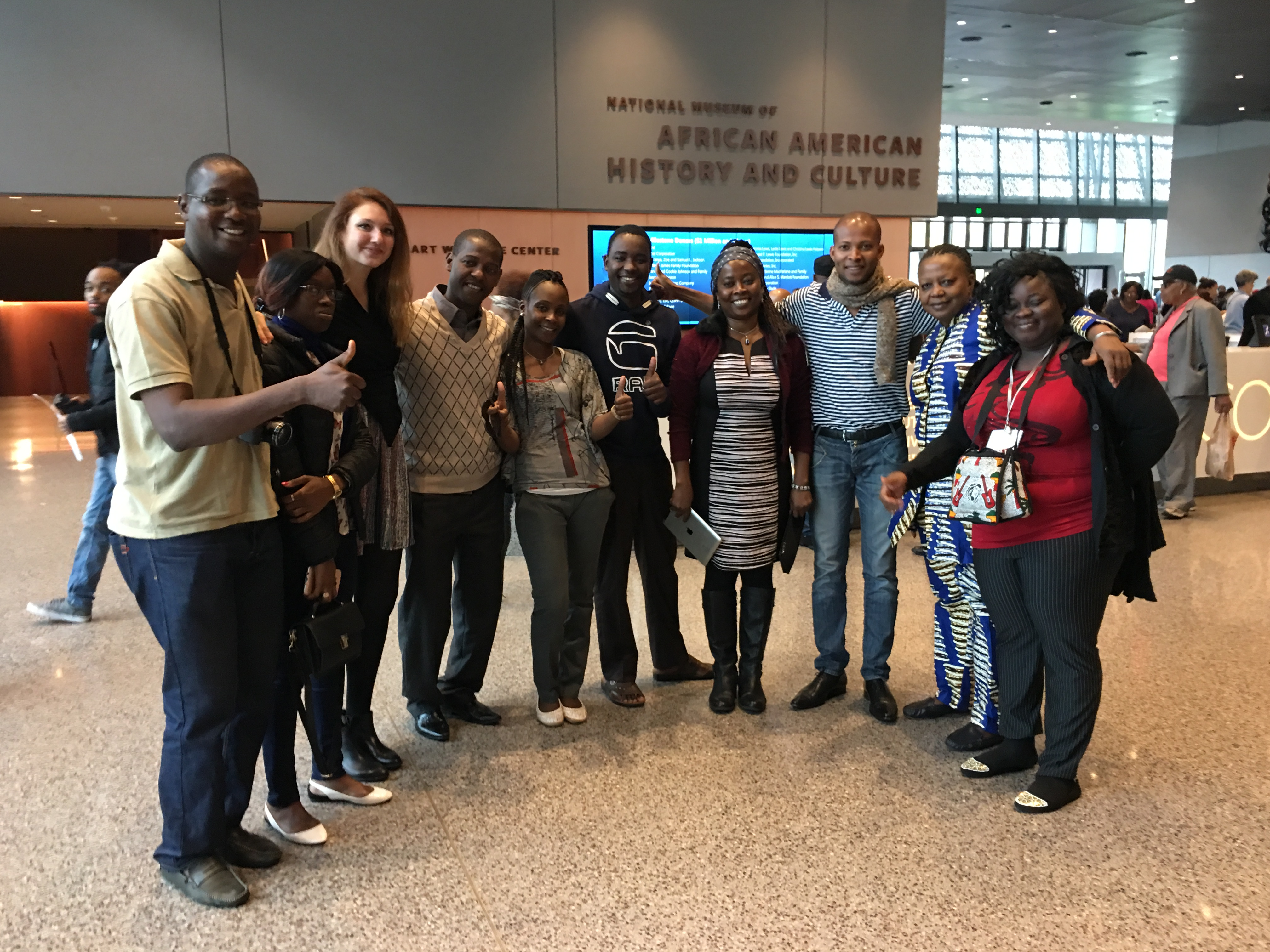 Participants take a group photo at the National Museum of African American History and Culture