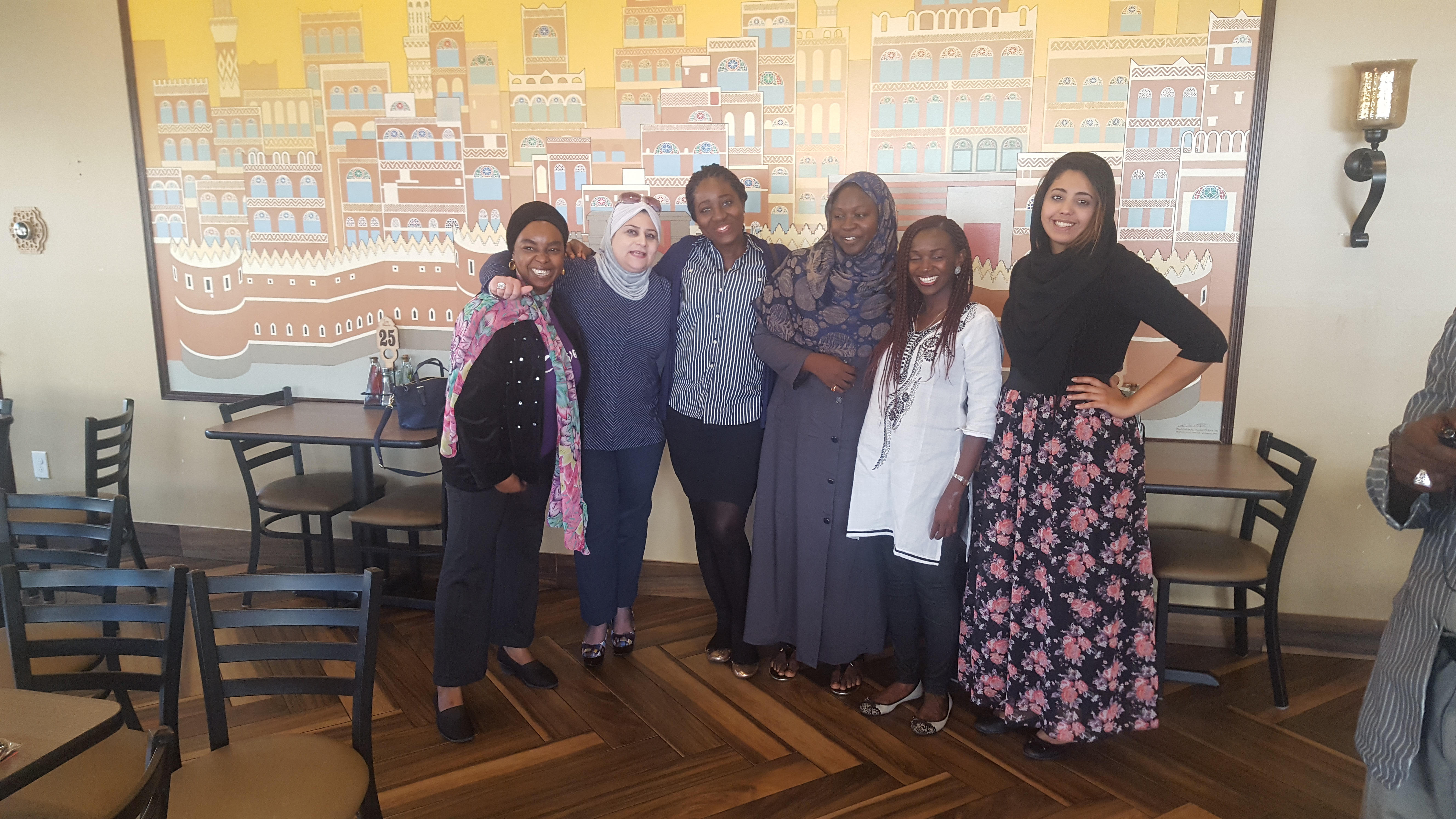 IVLP participants take a photo with Ms. Laila Alhusini, anchor of US Arab Radio (on the right) at Sheeba Restaurant.