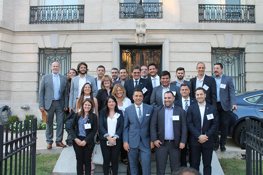 Participants took a group photo in front of the embassy of Argentina in Washington D.C.